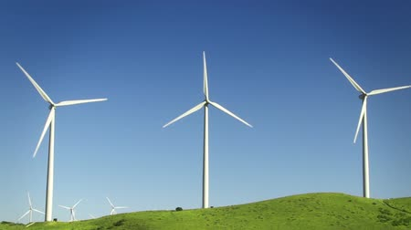 turbine : Spinning wind turbines on green hills and clear blue sky. Shot on 4:2:2  HD 1080p.