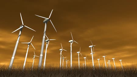 szélturbina : Spinning wind turbines with an orange sky, clouds and dry brush. 3D animation, seamless looping video.-