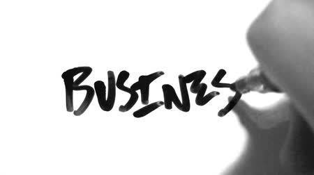 yazarak : Writing the words Business with black marker. Shot on HD 1080.- Stok Video