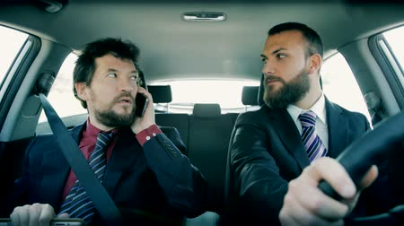 oblek : Happy cool handsome business men in suit in car