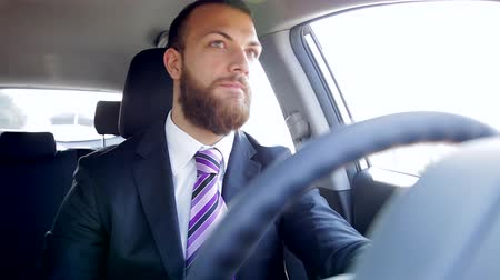 menő : Serious handsome business man with beard driving car