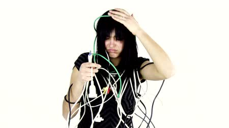 кричать : screaming woman desperate about cables surrounding her medium shot