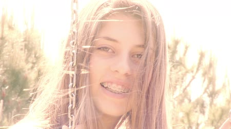 braces on teeth : Young female teenager with braces smiling looking during sunset
