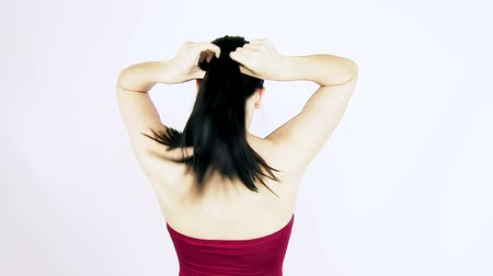 undo : Woman doing ponytail with long black silky hair