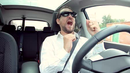 igen : Handsome businessman celebrating victory in car shouting