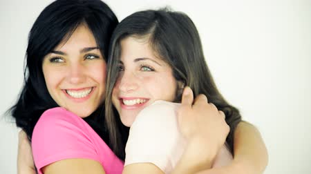 gülümseyen : Happy girls hugging strong friendship Stok Video