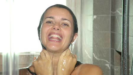 haj : Happy beautiful woman singing under the shower
