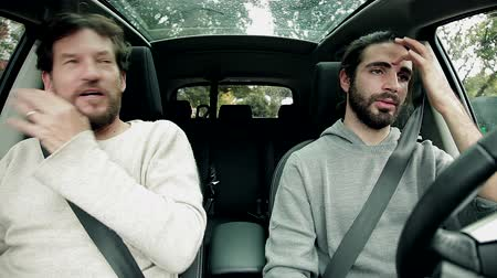two people talking : Two handsome men talking in car about women