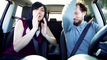 smell : Woman smelling stinky armpit of boyfriend driving car funny
