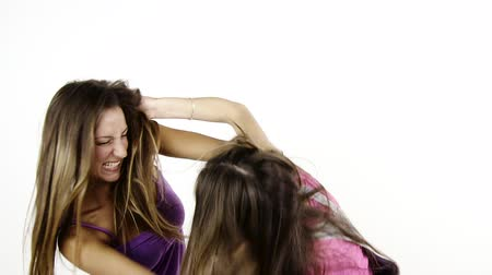 çekme : Two teen girls fighting hitting each other pulling long hair isolated Stok Video
