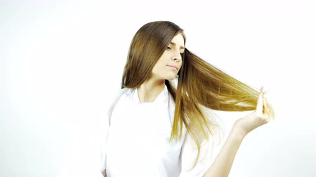 hajápoló : Beautiful woman touching long silky hair after haircut and style at salon isolated 4K