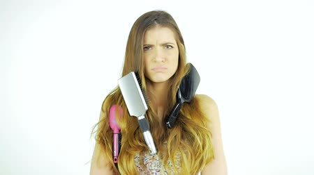 tüyler : Funny woman with messy long hair unhappy about brushing slow motion Stok Video