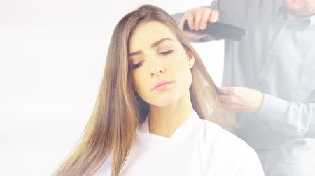 longo : Young woman getting long hair combed by stylist