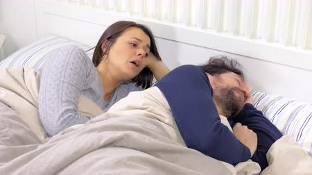 veszekedés : Couple in bed asking for forgive husband angry Stock mozgókép