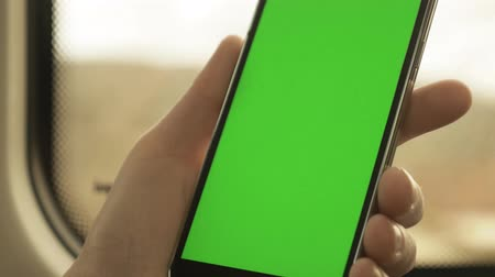 érintőképernyő : Green screened Smartphone in a train Stock mozgókép
