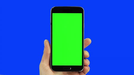 on the phone : Black smart phone chroma key blue and green with real hand