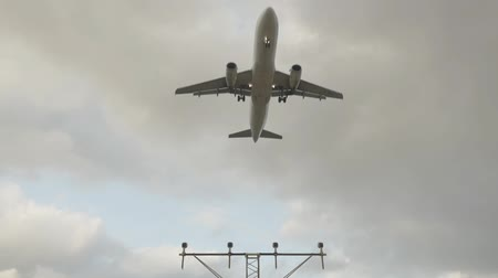 rovina : Slow motion airplane landing with cloudy sky