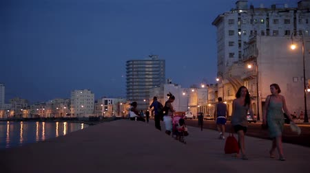 kuba : People walking in The Malecon at sunset in La Havana city in Cuba.