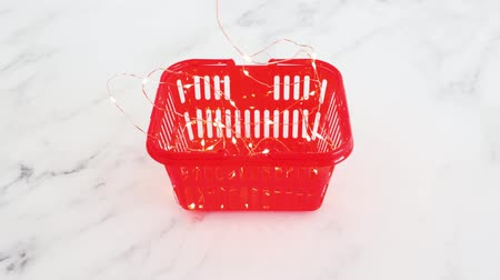 koszyk zakupy : brilliant marketing or exciting products, shopping basket with fairy lights flashing on and off inside of it