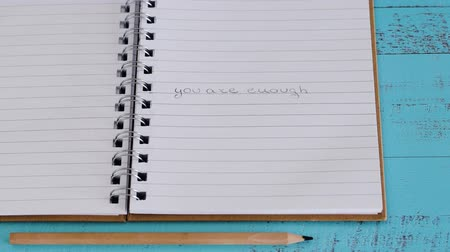 resmedilmeye değer : self-worth and mental health concept, You are enough message landing on notebook