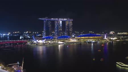 state park : SINGAPORE - JANUARY 12, 2019: Hyper-lapse footage of Singapore cityscape at dusk. Landscape of Singapore business building around Marina bay.