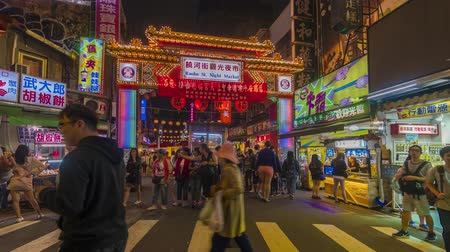 songshan : TAIPEI, TAIWAN - MAY 5, 2019: Time lapse 4k of Pedestrian at Raohe Night Market entrance
