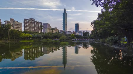 palmo : Time lapse Taipei City sunrise with cityscape view of Taiwan and reflection taken during sunrise