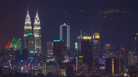 malajsie : KUALA LUMPUR, MALAYSIA - JUNE 21, 2019: 4k Time-lapse footage of Kuala Lumpur cityscape with Genting Highland at the background Dostupné videozáznamy
