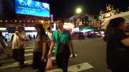 songshan : TAIPEI, TAIWAN - MAY 5, 2019: Pedestrian crossing the road at Raohe Night Market entrance