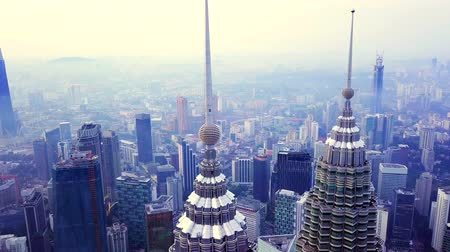 KUALA LUMPUR, MALAYSIA - JULY 3, 2019: 4K UHD close-up footage of Kuala Lumpur City Center (KLCC) in the morning captured using drone