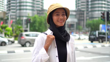 Travel Concept, Asian Tourist at Kuala Lumpur smile to the camera Stock Footage