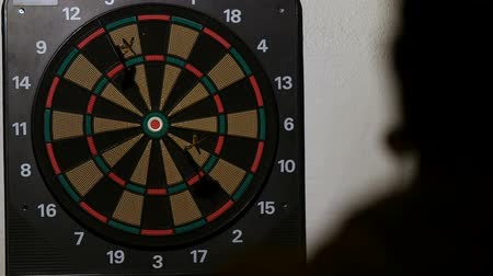 dart : man playing a game of darts, focus on target Stock Footage