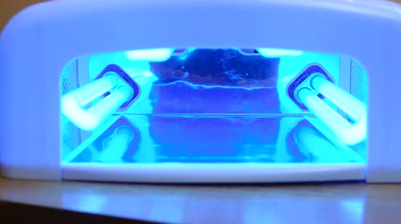 ultraviolet : UV lamp for manicure closeup. 4K video Stock Footage