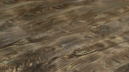 laminált : Laminate flooring in 4K resolution. Texture of the decorative floor panels Stock mozgókép
