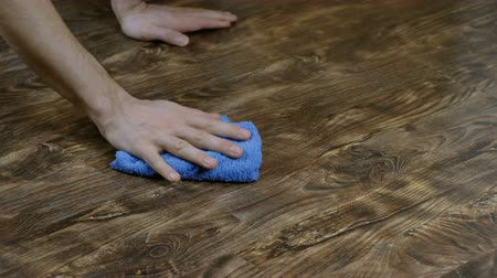 laminát : man washes floor cloth. Male hand wipes the puddle of milk on laminate, the mens housekeeping, 4K