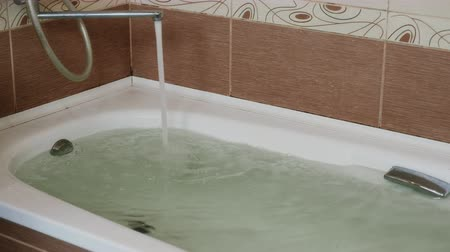 hot tub : Strong jet of water flowing from the faucet into the tub. Full bath.