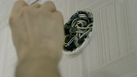 heat resistant : Close-up mans hands repairing the wires on electrical junction box with screwdriver