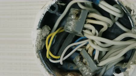 heat resistant : Close-up view of burnt wires in electrical junction box on the wall under the ceiling. Stock Footage