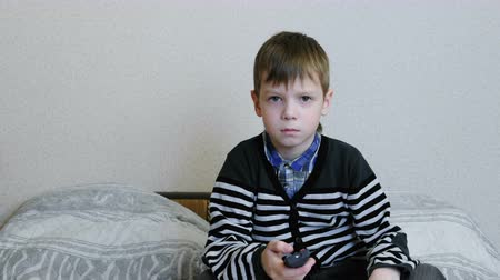 небритый : Watching TV. Bored boy is watching TV and switches the channels.
