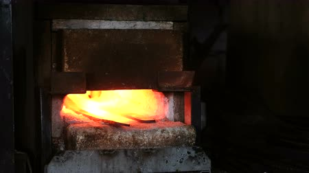 brusič : Making the sword out of metal at the forge. Heating of metal billets in the furnace.