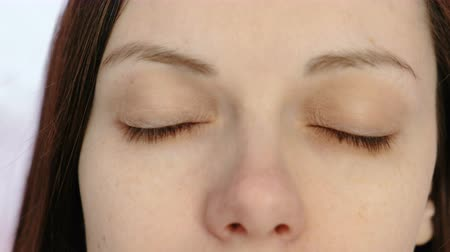 restful : Young brunette woman with closed eyes. Eyes and nose close-up