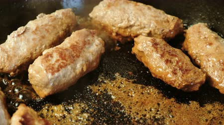 kıyma : Tasty meat cutlets are fried in oil in a pan. Close-up top view.