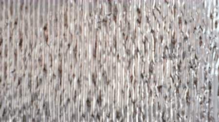desigual : Silvery shiny wall coating, heat insulation material. Blur.