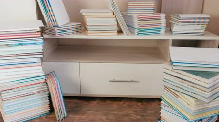 ansiklopedi : Pile of books on the floor and on the closet. Stok Video