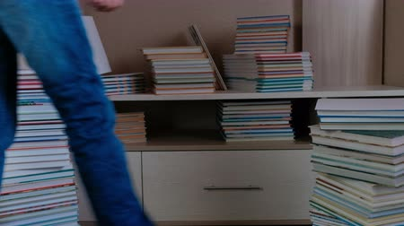 alfabetização : Woman cleans the book. Takes them away. Legs close up. Stock Footage