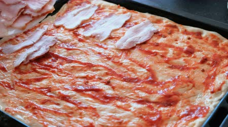 sıkı : Cook preparing pizza. Closeup womans hands put meat to dough with sauce. Stok Video