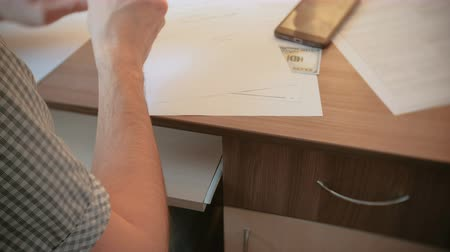 последний : Man writes a will and pulls out a gun from the drawer. Closeup mans hand Стоковые видеозаписи