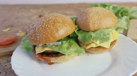 kepekli : Two different homemade burgers on the white plate.