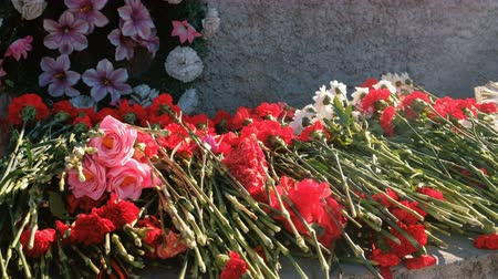 sosyalizm : Flowers placed at a monument for victory day of World war.