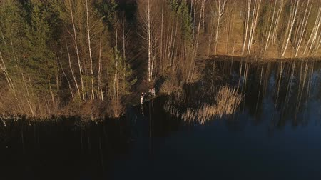fly fishing : People fishing on the river in the forest. Flying aerial video.